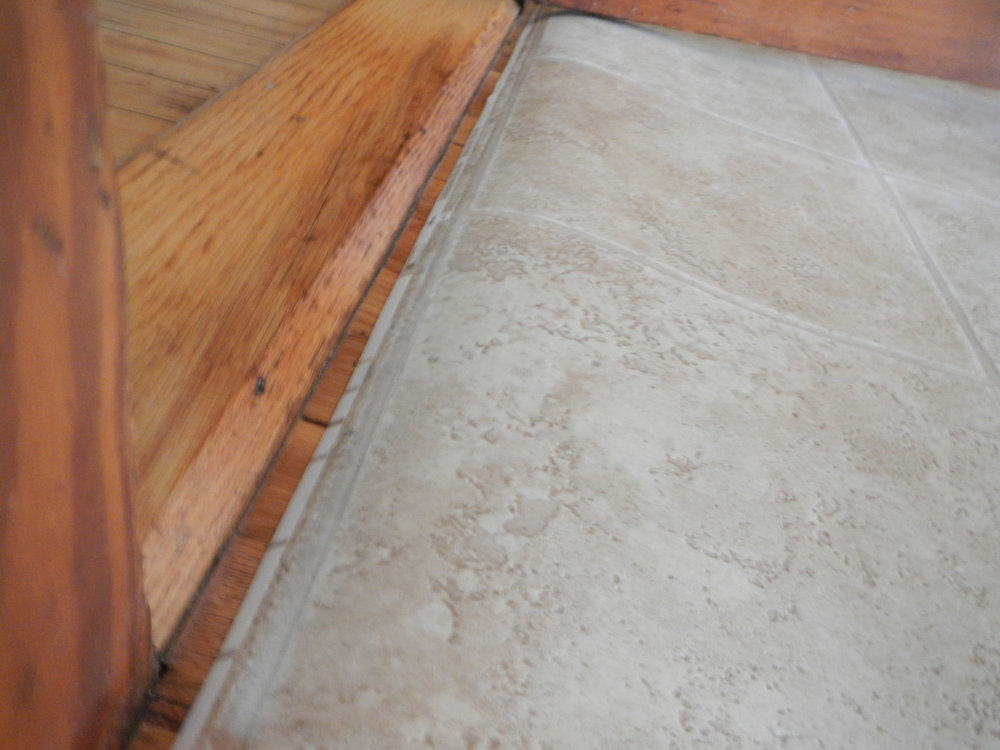 Rolled flooring tends to keep it's curl for a while and that can be a danger to feet.