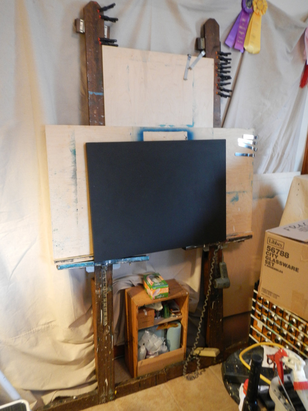All together, it makes a cheap but sturdy easel.