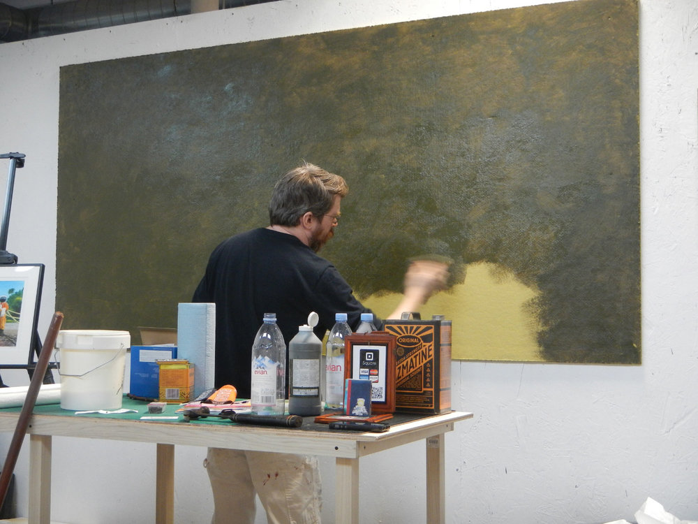 I'm painting the bulletin board a Gallery Green for viewing artwork on.