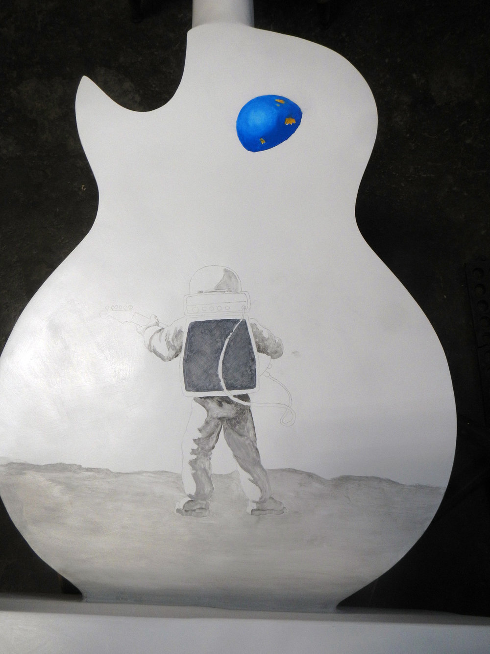 While the front was drying, I was able to flip the guitar over to start painting the back.