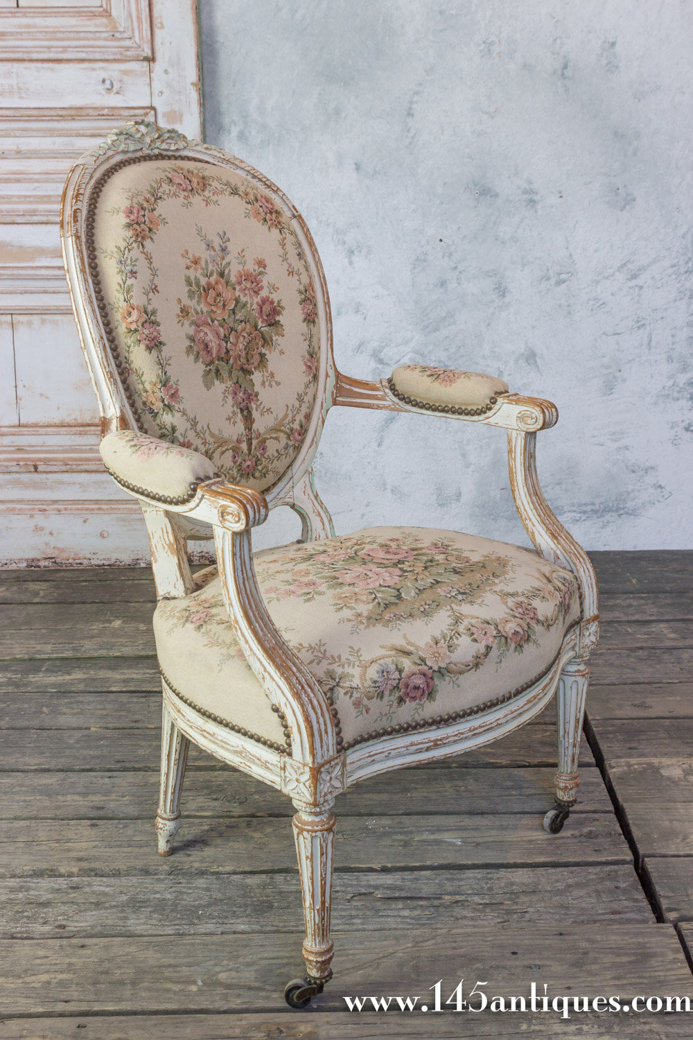 Charmant Pair Of French 19th Century Louis XVI Style Armchairs In Petit Point Fabric