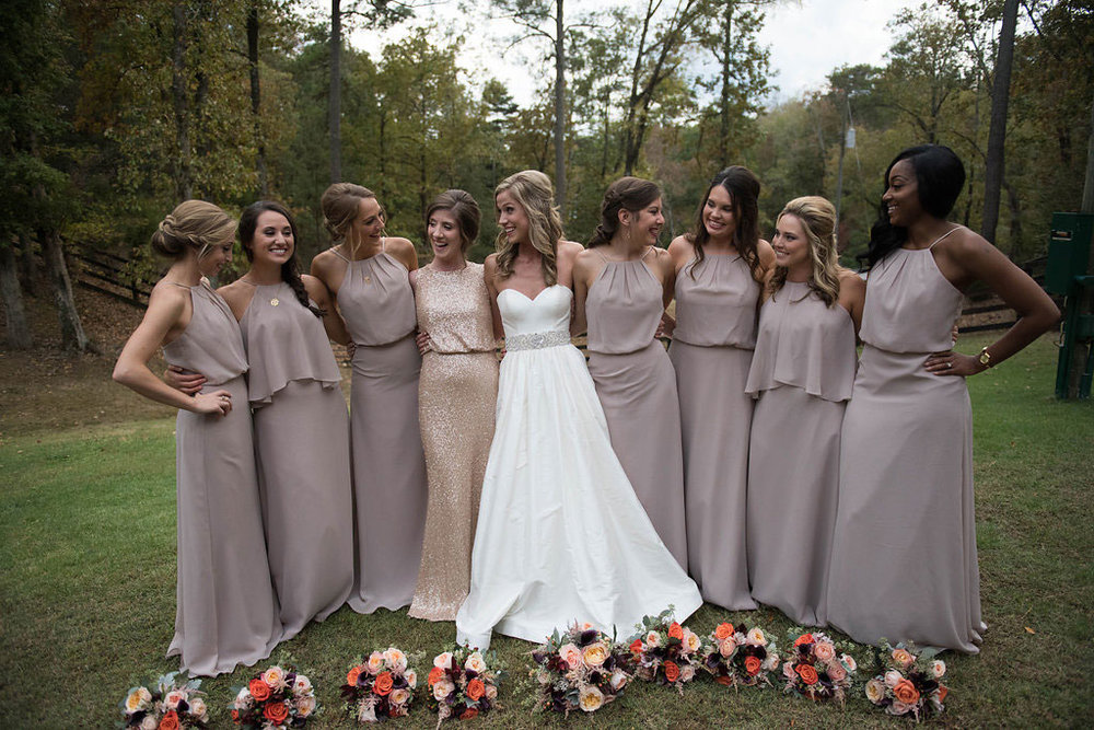 Sarah Beth selected a dress for her maid of honor that was glittery gold. Photo:  Katie Wallace