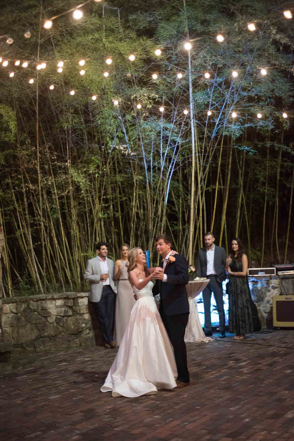 A simple strand of lights strung high at Sarah Beth and Fate's reception creates a fairy tale setting. Photo: Katie Wallace