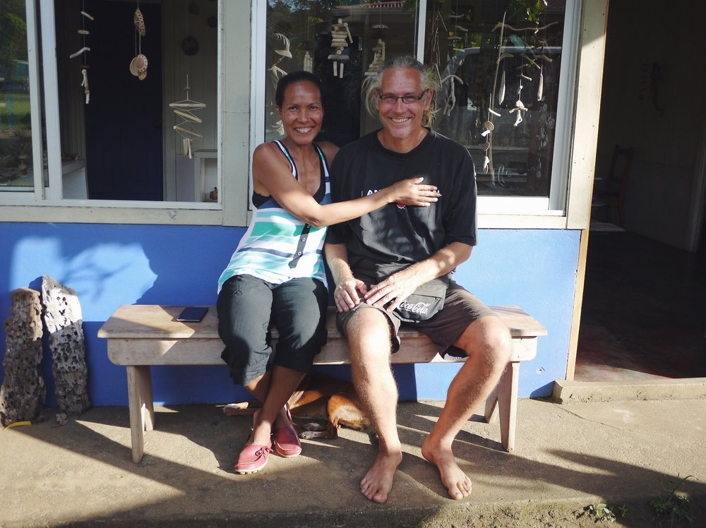 """Marta and Lars. A kind Tico-Swedish couple living in Corozalito, Costa Rica. (She's covering up his """"I'm Canadian"""" t-shirt to avoid confusion.) We found them after following a series of small, colorful cafe signs only to learn the cafe had closed last year. She generously invited us in and offered to make a couple cups anyway. 4.5 hours later we pedaled away after 2 cups of coffee, wine, a 3-course lunch and some serious warm fuzzies. If you're in the market for a farm in Costa Rica, we know a guy."""