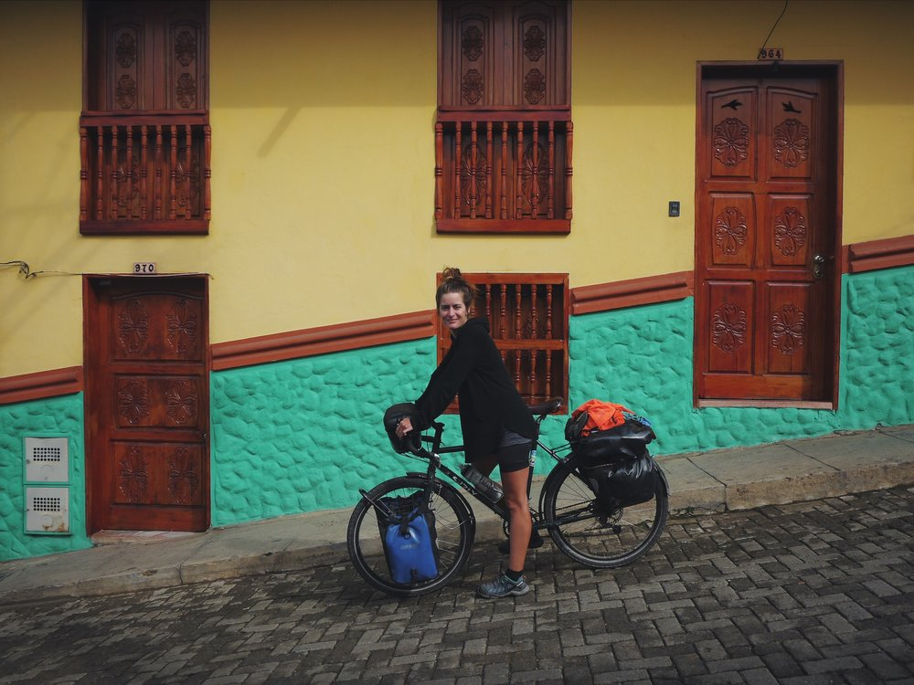 The bright colonial villages of the Colombia cafetero. Note the grade and the smile.