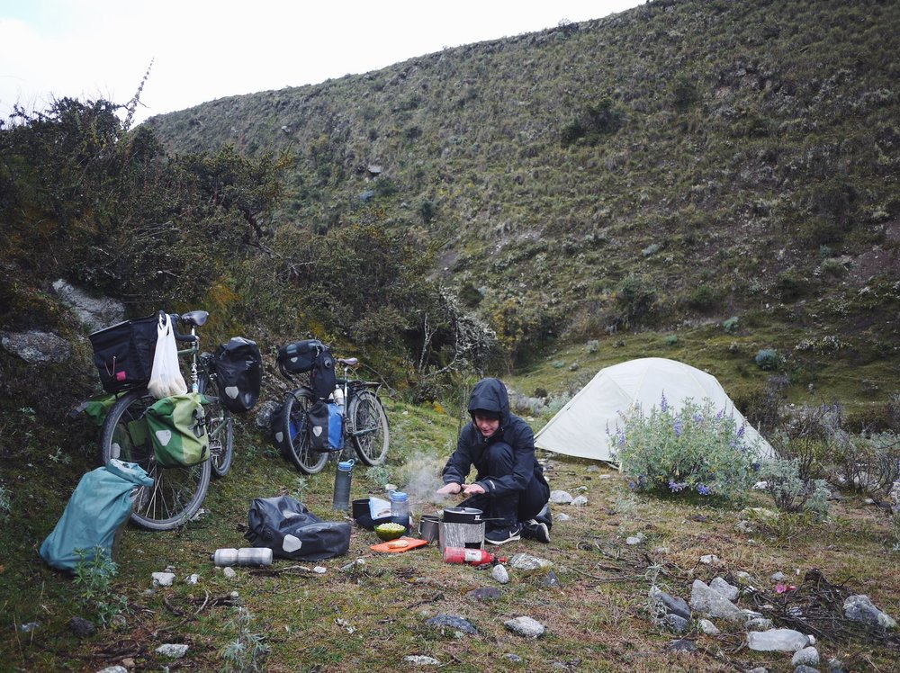 Heating up water for a night bottle—a sleeping bag essential at altitude—according to Tara.