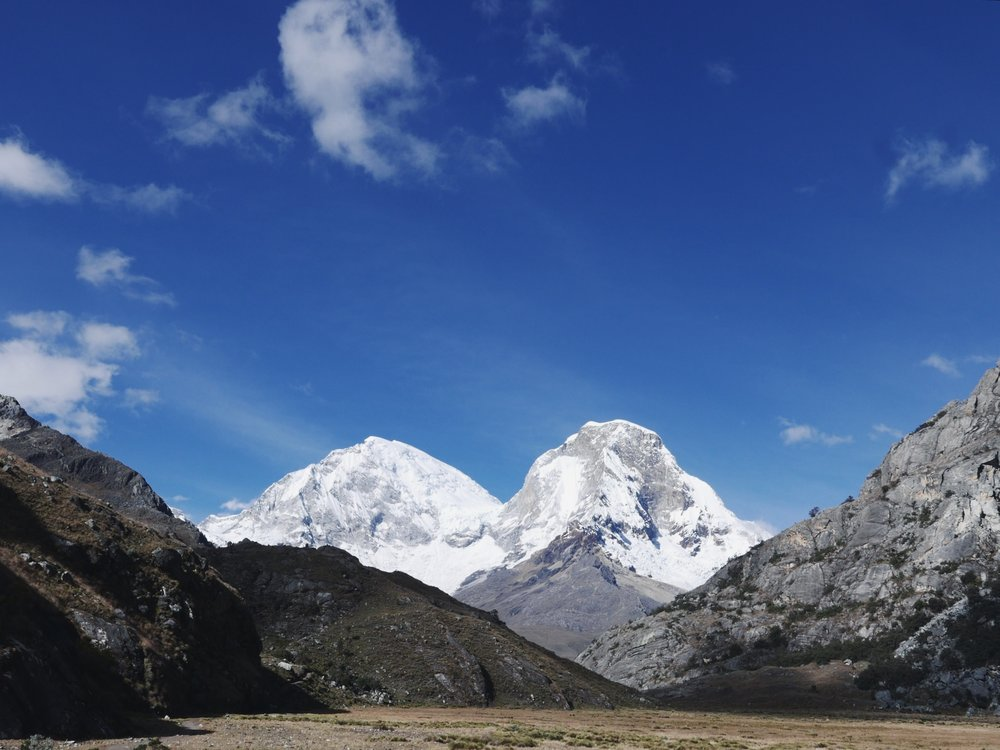 Huascaran Norte, on the right, has a tragic history. In 1970 during a 7.9 earthquake, the front portion of the mountain broke off and buried the towns of Yungay and Ranrahirca in a wave of ice, rock and mud in less than five minutes, killing some 20,000 people. A beautiful, but ominous backdrop for those towns.