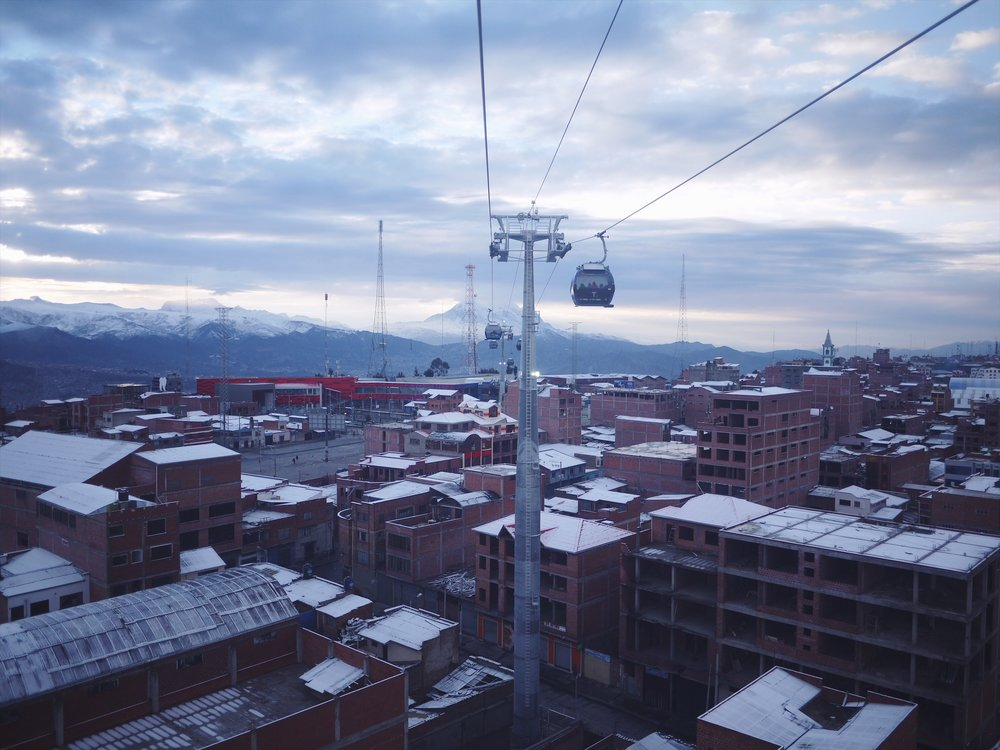 And on the way out, we opted for an early morning teleferico bump. A cold lift out of the city. Illimani frozen in the background. El Alto, the city's upper sprawling suburb waking up below.