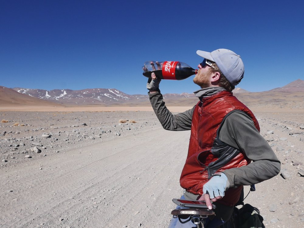 Even though things seem remote, hundreds (dozens?) of jeeps filled with adventure tourists tore past us every day. Their only redeeming quality being that sometimes they offer goodies. We asked for water and got the Bolivian equivalent—2 liters of cyclist motor oil.