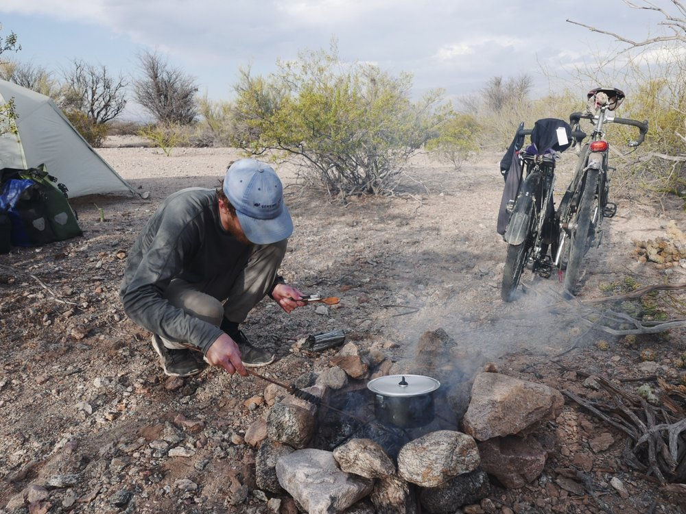 When you both forget to hit the gas station on the way out of town...Aidan's scavenged rebar grill and fire pit fueled on desert scraps cooked our pasta in three times the normal time. A few minor burns and a lot of cookwear charring and again we are reminded how good we have it with the trusty MSR stove.