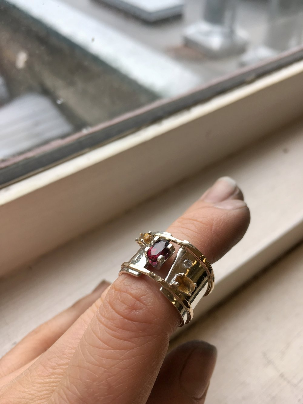 Old made new.   Sterling silver, 10k gold, citrine, garnet, diamond.