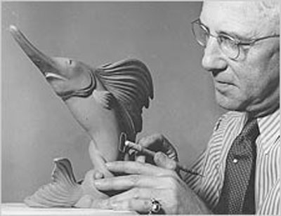 Royal A. Hickman's work was characterized by smooth flowing lines and highly original glazes.