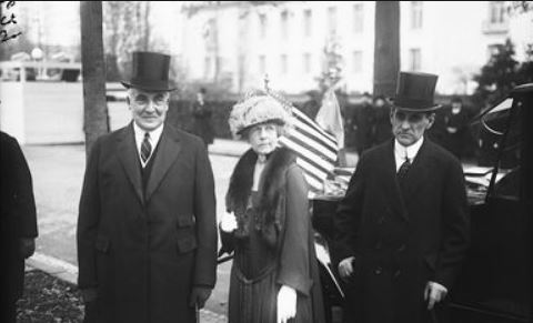 Warren G. Harding wears a now collectible top hat.