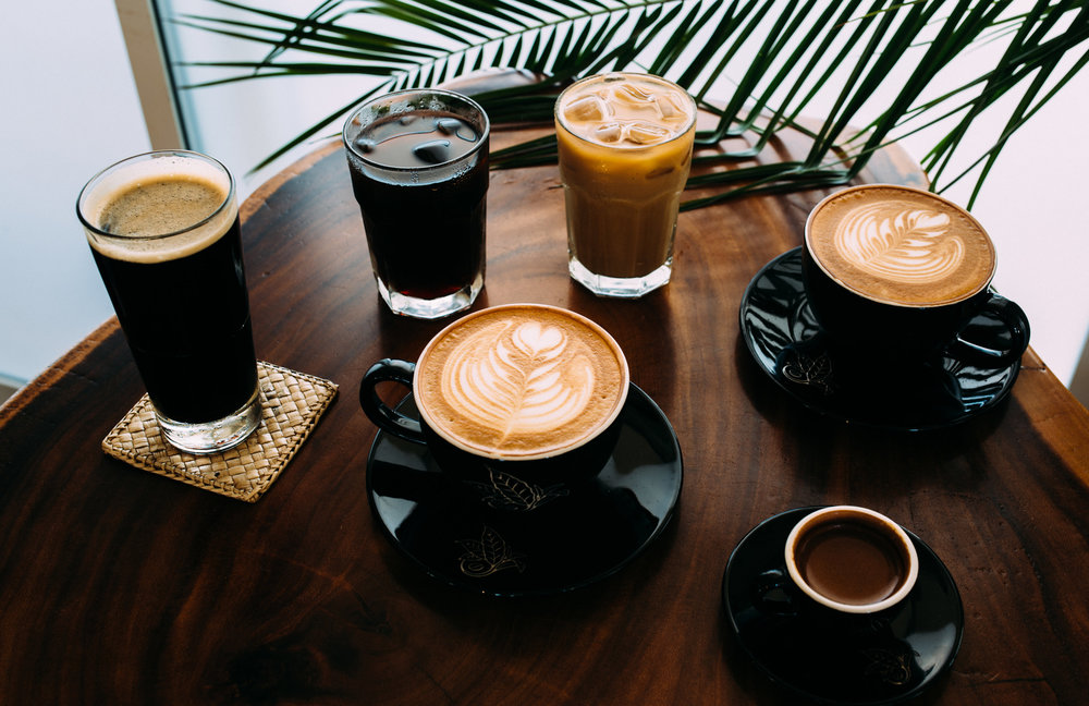 A variety of different caffeinated coffee drinks at Kona Coffee & Tea's Kailua-Kona café. PHOTO: Blake Wisz