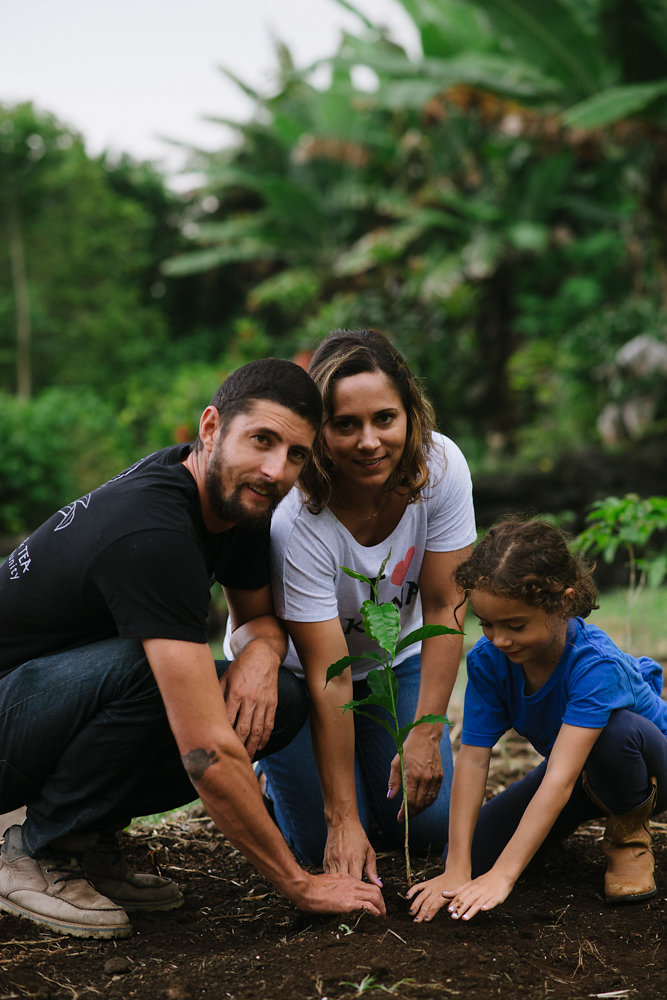 Danny, planting coffee with his wife and daughter. PHOTO: Blake Wisz