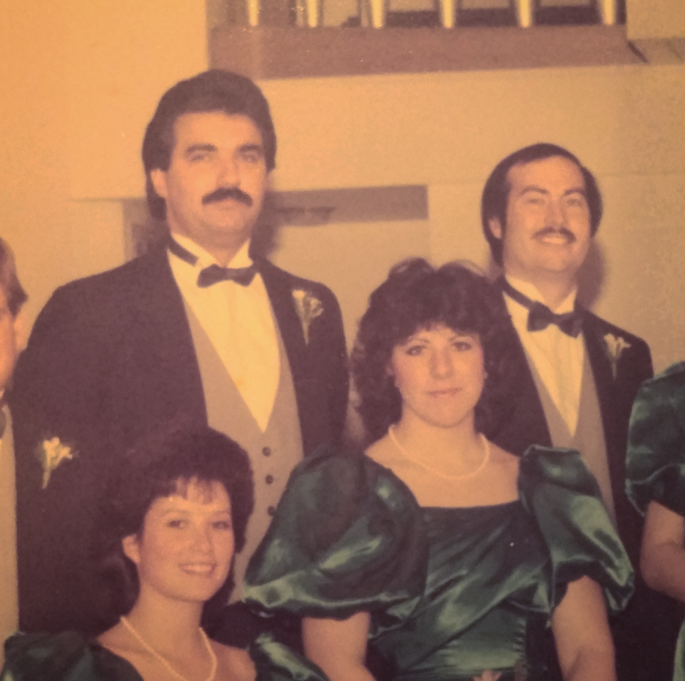My doppelganger hunting includes vintage finds - like this 80's pic of my mom and a Tom Selleck lookalike at a wedding.