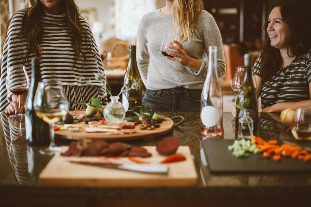 girls at a party, food and wine