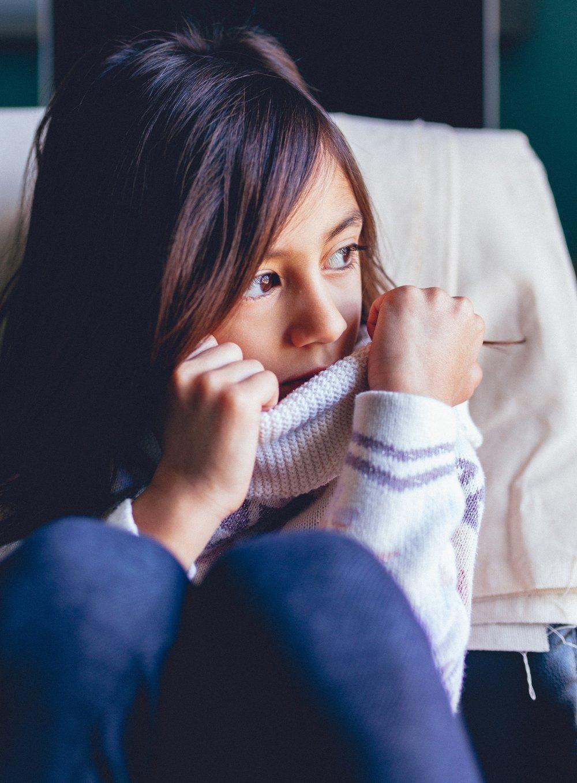 girl wearing sweater
