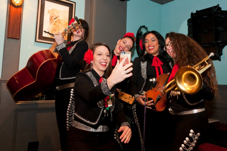 Mallozzi celebrating the shoot with members of Mariachi Flor De Toloache.