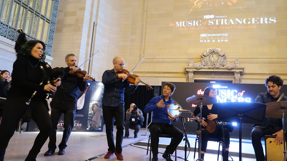 Cristina Pato leads the other members of The Silk Road Ensemble at a performance in Grand Central Terminal's Vanderbilt Hall (photo by Mickela Mallozzi).