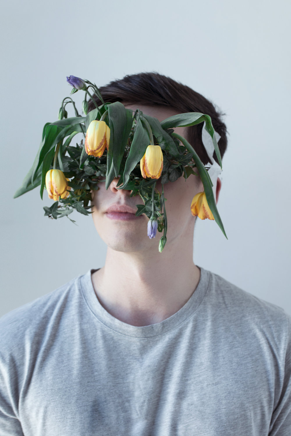 fragility - The series emphasises a universal connection of man to nature. Using florals to mask the dominant facial features of the male subject