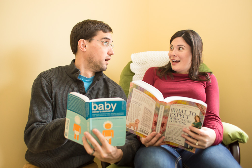 "Expectant parents reading ""What to Expect When You're Expecting 