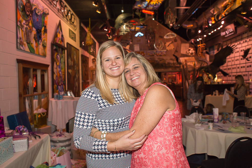 bride hugging her mom during bridal shower best rochester ny venues artisan works
