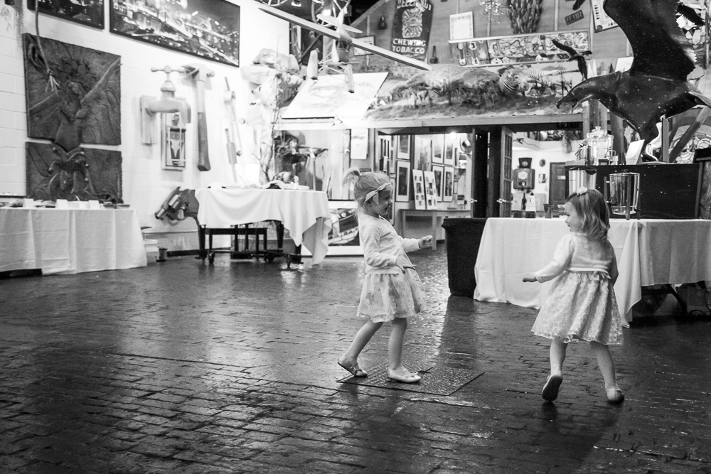 Flower girls having fun running around the venue