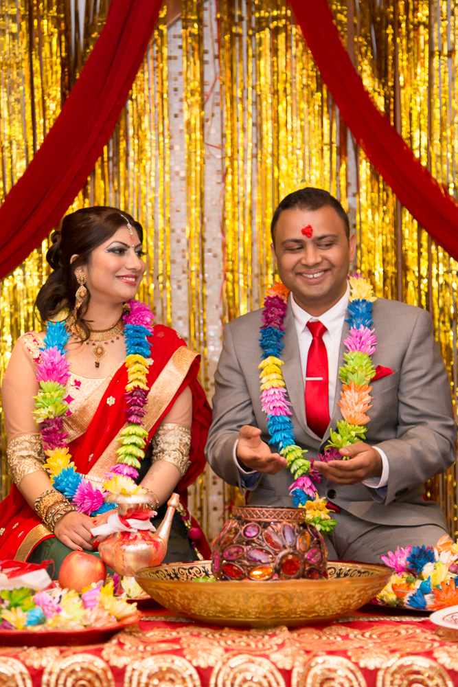 Bride and groom during their Nepali engagement ceremony