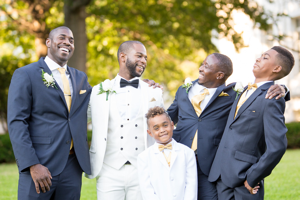Groom and groomsmen posing after the wedding ceremony at DAR Museum | Washington DC