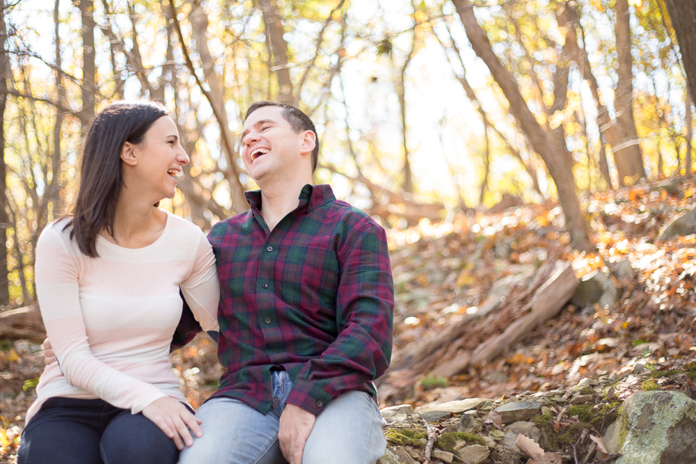 Candid laughter photo during engagement session in Shenandoah National Park | Shenandoah wedding photographer