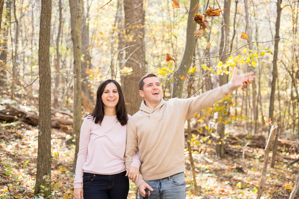 Goofing around with the fall leaves during engagement shoot