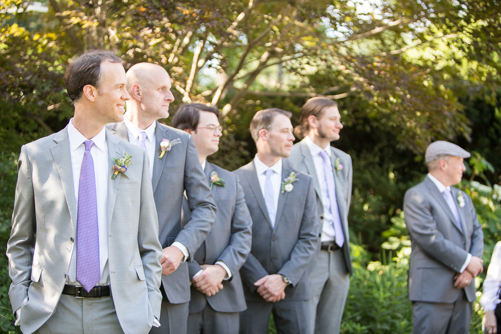 Groom watching his bride walk down the aisle at Airlie | Warrenton Virginia Weddings