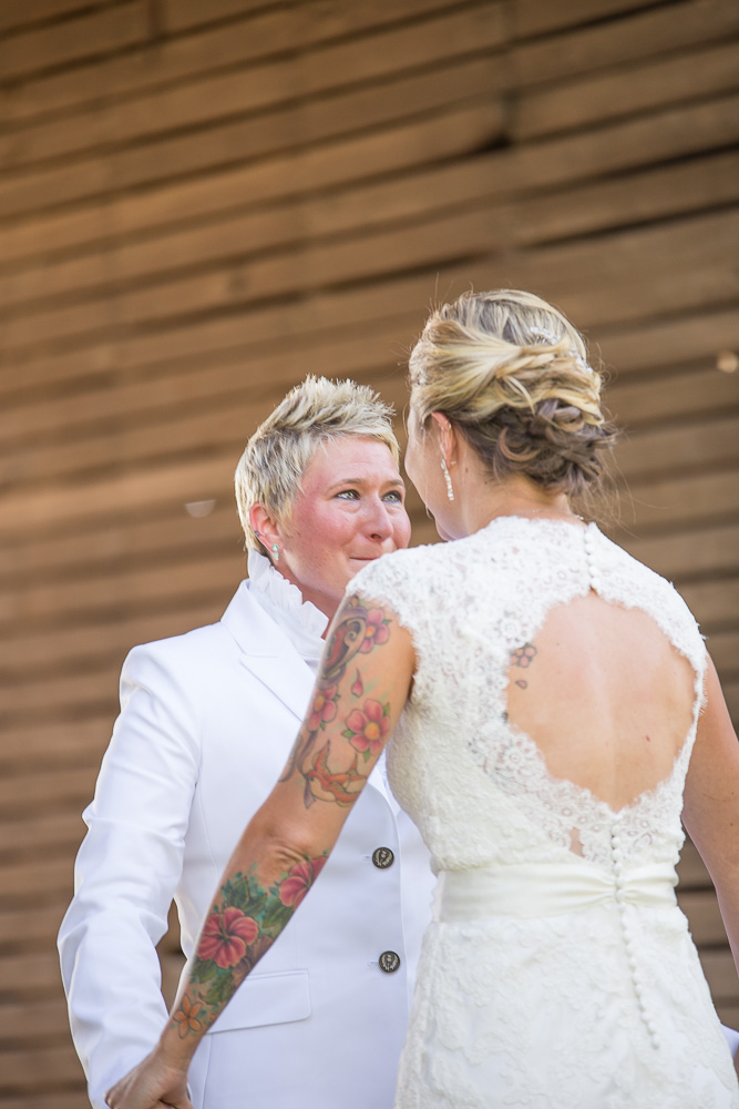 Emotional wedding photos during same sex wedding in DC area | Linganore Winecellars wedding