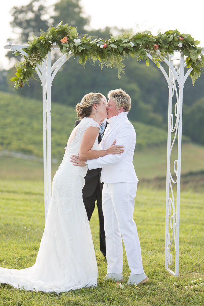 First kiss during the wedding ceremony at Linganore Winery in Maryland | DC lesbian wedding photographer