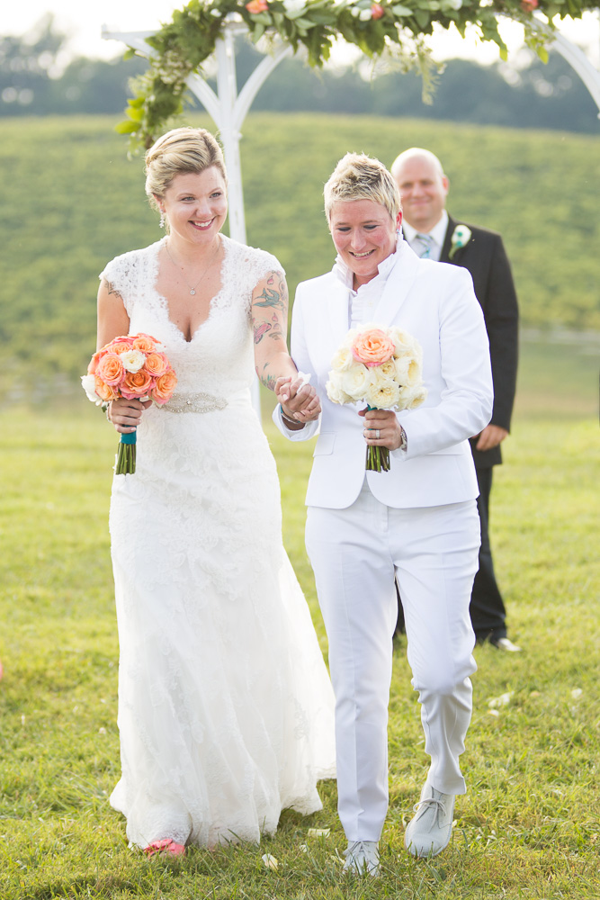 Two brides walking up the aisle after the wedding | DC LGBT wedding photographer