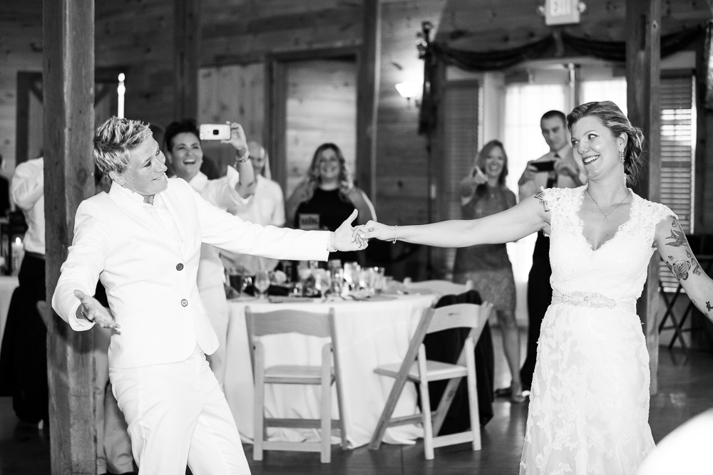 Brides having fun during their wedding reception | DC LGBT wedding photographer