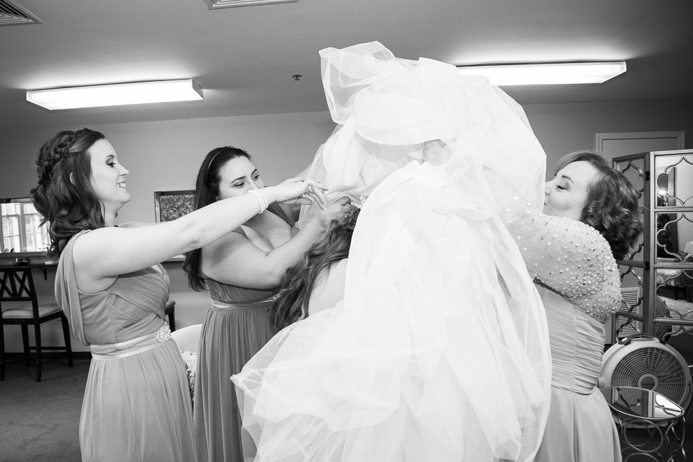 Putting on the wedding dress | Haymarket Virginia Wedding Photography