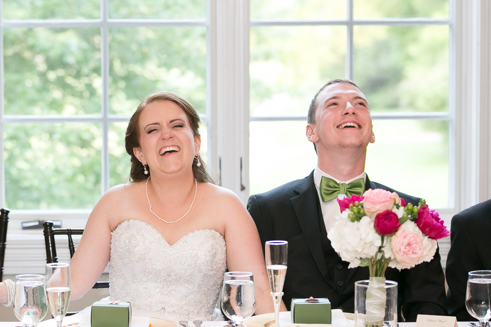 Bride and groom laughing during the toasts | Documentary style wedding photography in Northern Virginia | Megan Rei Photography