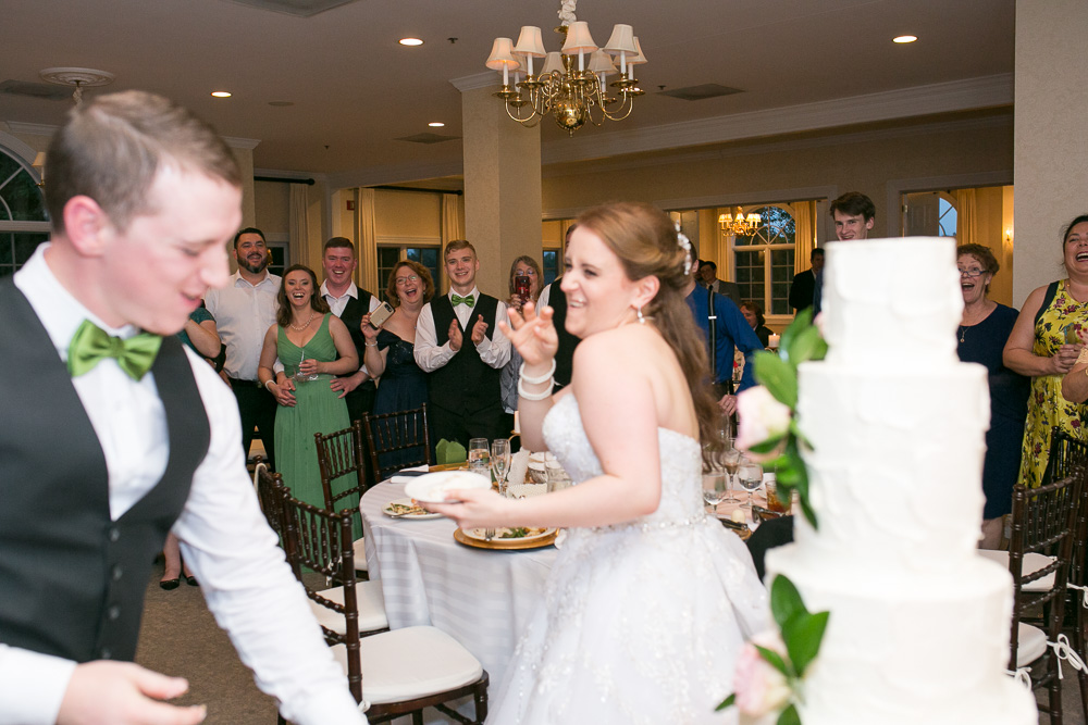 Fun wedding cake cutting | DC wedding photographer with photojournalistic style
