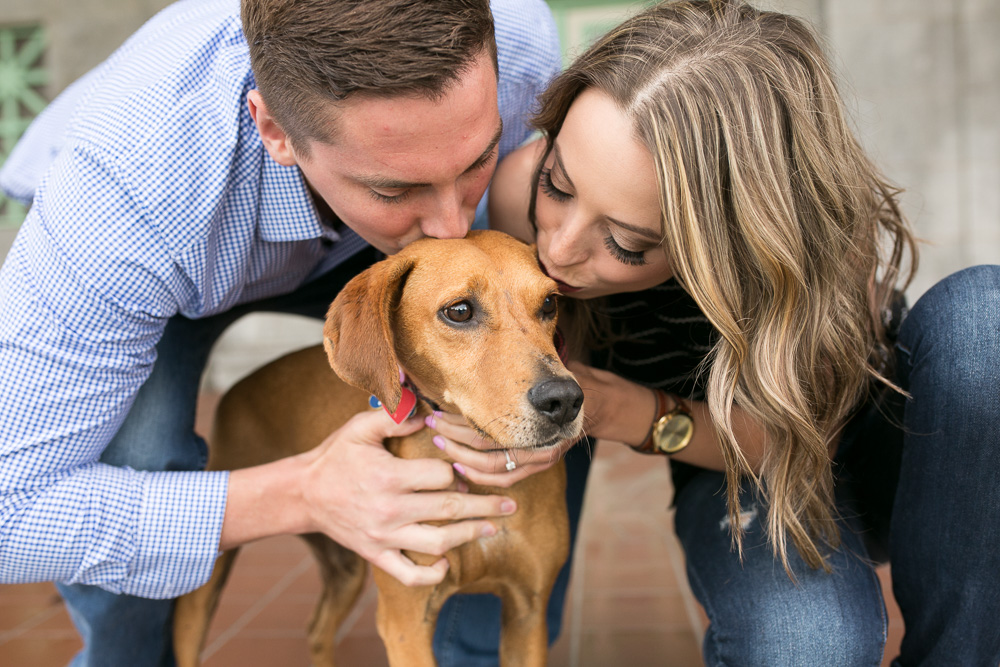 Engaged couple giving kisses to their dog |Engagement photography in Rochester, New York