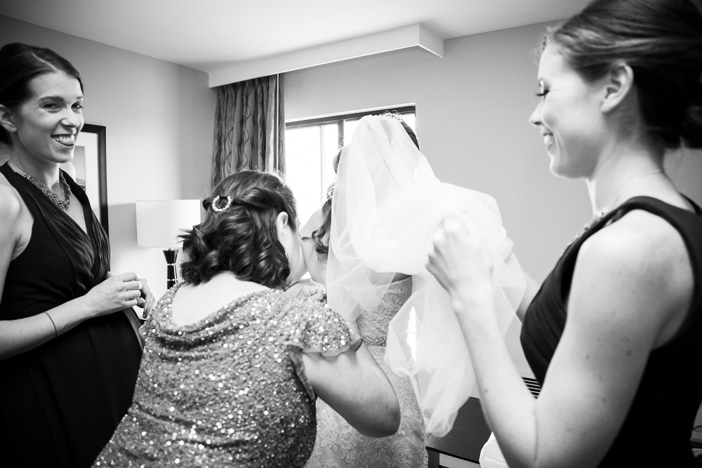 Putting on the wedding dress | Candid wedding photographer | Megan Rei Photography