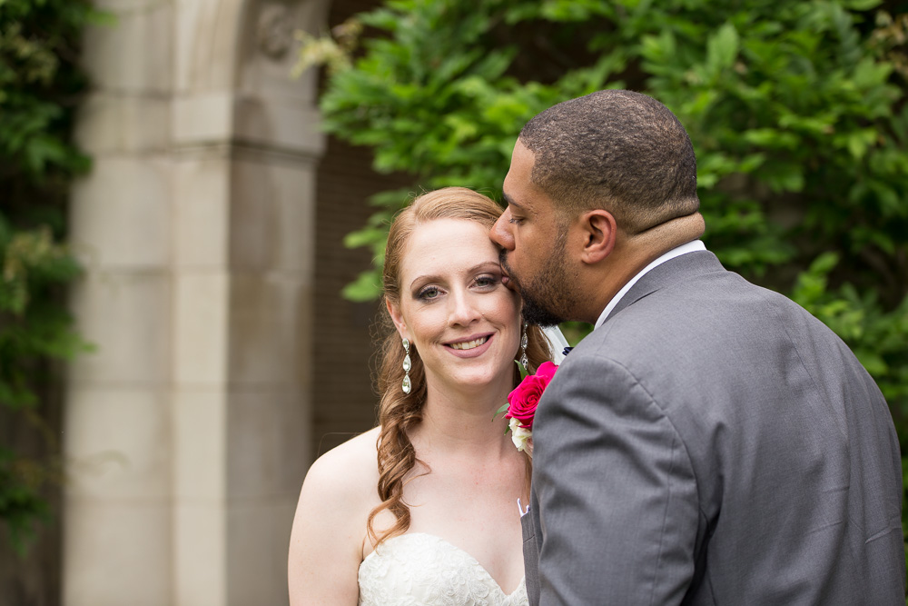 Groom giving bride a kiss at George Eastman Museum | Best Places for Wedding Photos in Rochester, NY | Megan Rei Photography