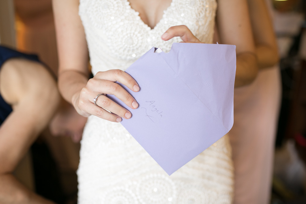 Opening a letter from the groom | Documentary wedding photography in Northern Virginia