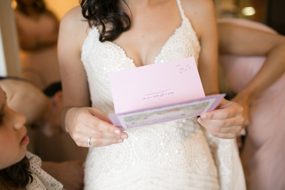 Exchanging letters on the wedding day | Wedding detail photographer