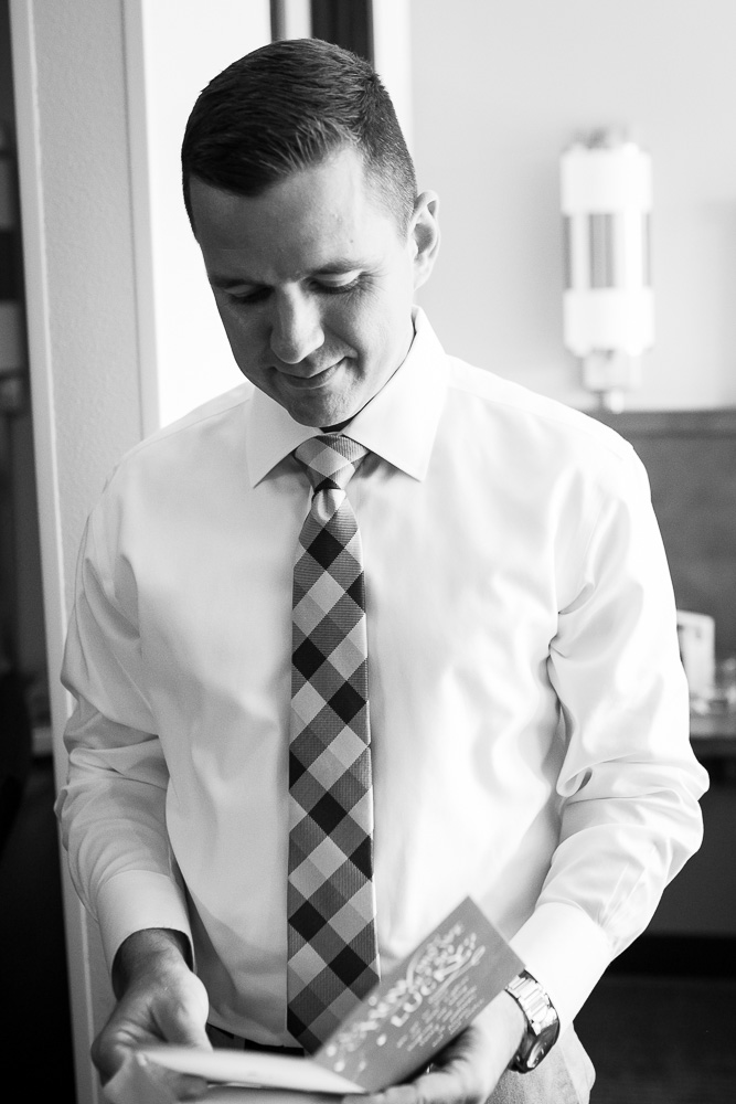 Groom reading a letter from the bride | Documentary Style Wedding Photography in Northern Virginia