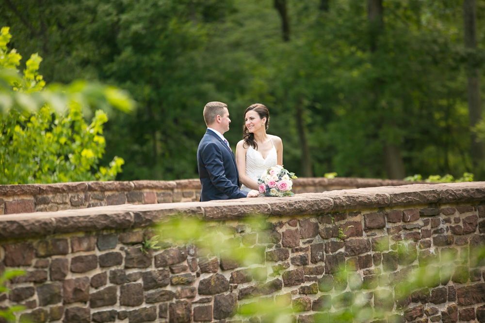 Wedding photos at the Stone Bridge in Manassas Battlefield | Best outdoor locations for wedding photos in Northern Virginia | Bull Run Winery Wedding Photographer | Megan Rei Photography