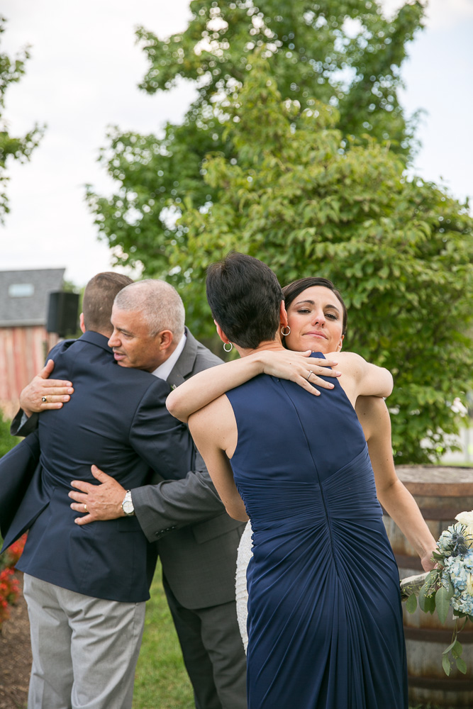 Wedding couple hugging bride's parents