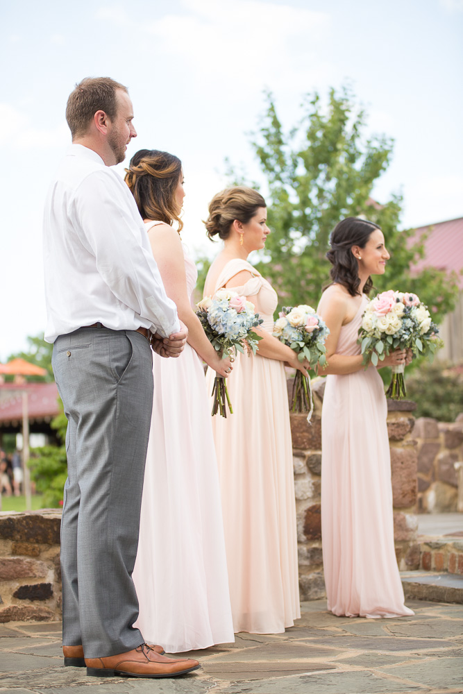 Bridal party watching the wedding ceremony | Summer wedding in Northern Virginia