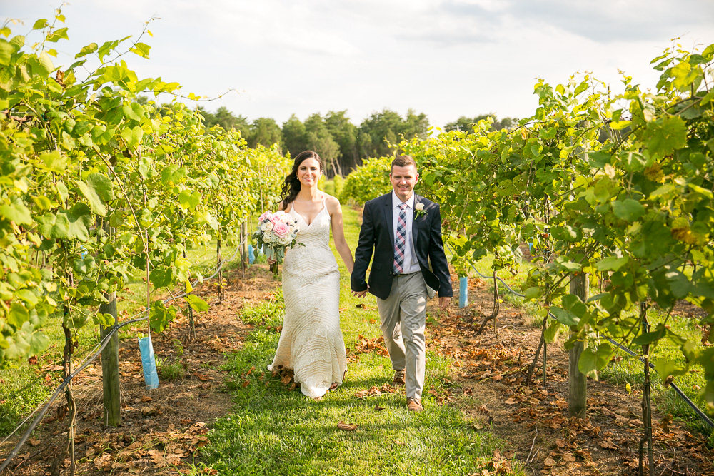 Bride and groom walking through the vineyard at Bull Run Winery | Winery Wedding Venues in Virginia | Manassas, Virginia